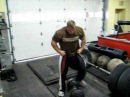 Derek Poundstone 200 lb Circus Dumbbell Clean and Press for 15 reps