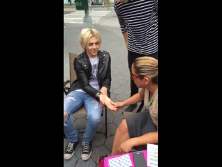 R5 getting a free palm reading for sometime last night (snapchat: r5snaps)