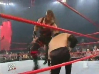 Christian(C) & Lance Storm (C) vs. Bradshaw & Kane - for the WWE Tag Team Championship, WWE Monday Night RAW 09.09.2002
