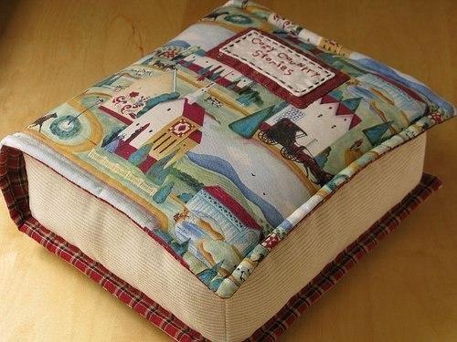 Просто подушка в форме книги.