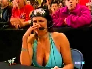 Stephanie Mcmahon interferes and gets beat up