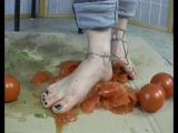 Dasha squishes tomatoes under her bare feet