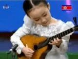 Little North Korean Girl Playing String Instrument