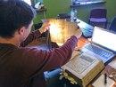 Ищем на просвет филигрань - авторский знак производителя бумаги, который позволяет её датировать.