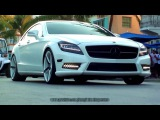 Awesome White Mercedes Benz CLS (W218) with Vossen black-white rims driving at Ocean Dr Miami Beach