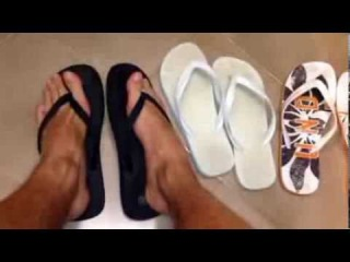 Young Male Feet: worn flip flops. From black to white to fantasy flip flops sandals.
