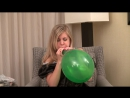 Girl blow up balloon and sit pop on chair