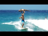 Two Surfers Perform Acrobatics