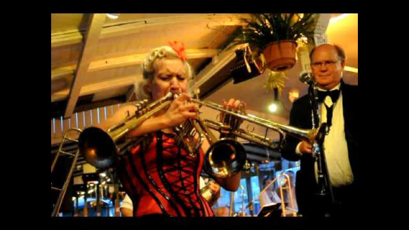 Gunhild Carling plays three trumpets at the same time