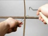 Tying reinforcing steel bars (rebar). Wi