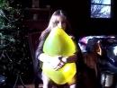 Alena squeeze to pop a yellow balloon