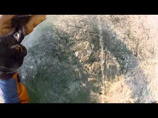 эпизод с купанием в лыжах на Байкале .