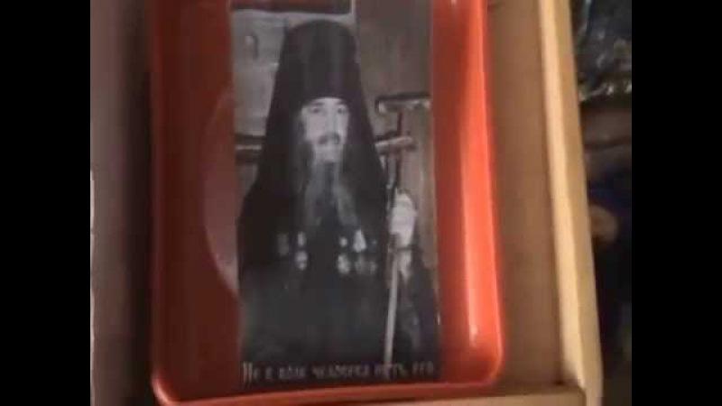 Обильное мироточение фотографий отца Василия Новикова