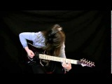 Adolescent girl plays solo guitar