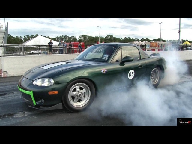 TESLA P85 Gets ZAPPED by Electric MIATA !! - 1/4 mile Drag Race Video - Road Test TV