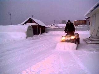 Уборка снега квадроциклом Stels 500 GT
