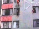 Abseiling fireman save woman from 10th floor SUICIDE JUMP