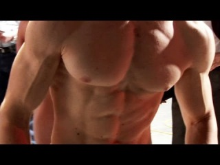 Ripped aesthetic junior bodybuilder during contest weigh in
