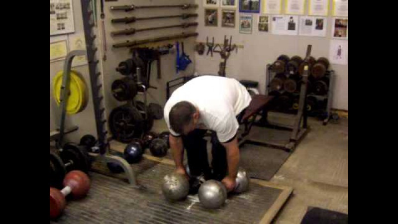 Laine Snook- deadlifting two Millennium Dumbbells - first man in History to do this.