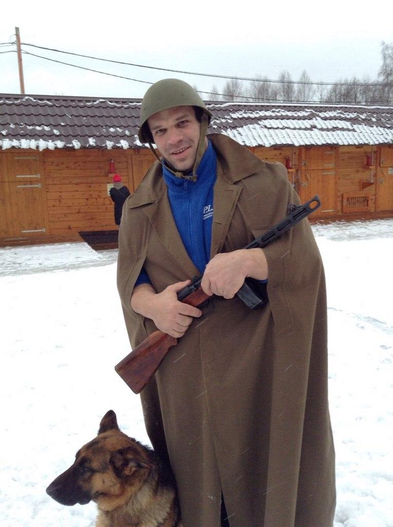 Denis Cyplenkov with a rifle, combat helmet / battle helmet, army coat and a dog :) │ Image Source: Denis Tsyplenkov