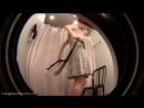 Hidden shop camera catches a beautiful girl trying out various summer dresses