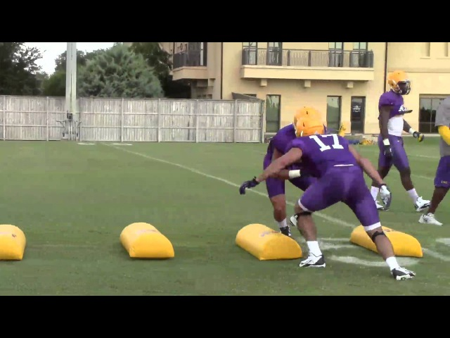 LSU assistant coach Brick Haley puts linebackers through a tackling drill Video