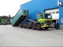 Крюковой погрузчик Hyvalift загружает 40 тонный контейнер на GINAF 10x4