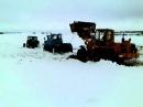 Вытаскивание погрузчика Амкодор из снега 2