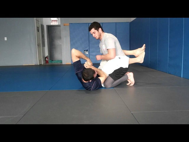 Overhook closed guard to Renzo arm in guillotine