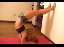 Learn to do Scorpion from Forearms with a Yoga Block and the Wall