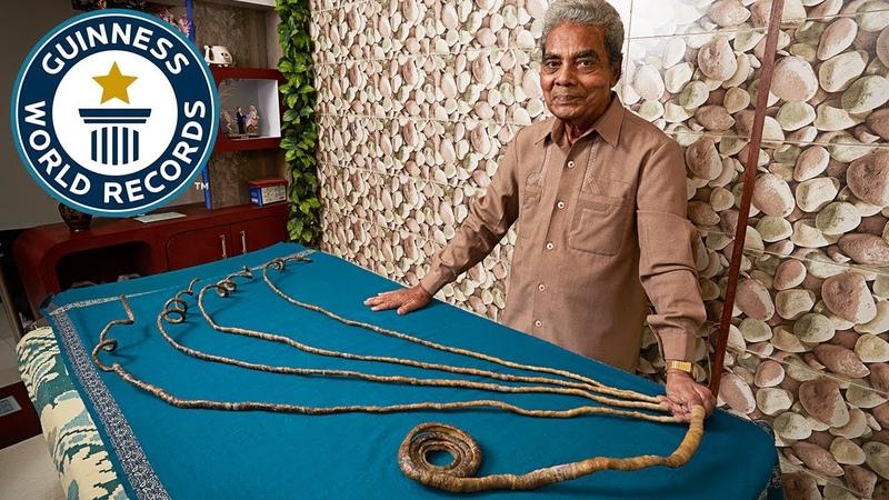 Cutting the longest fingernails ever - Guinness World Records