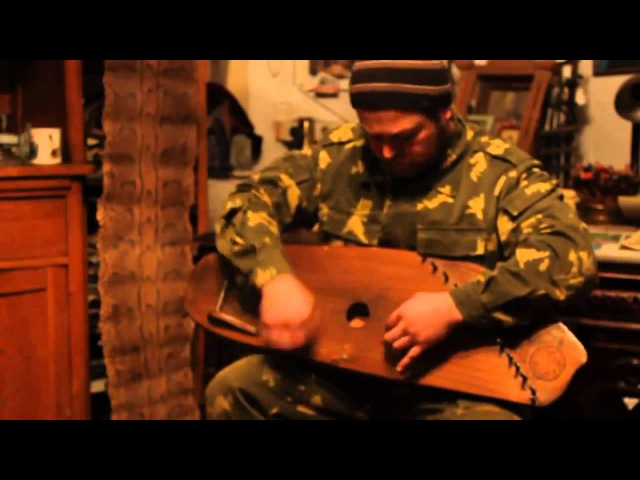 Roman Tunyakin is playing gusli (cymbal) and singing old folk Russian knight ballad