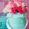 Свежие цветы в шляпных коробках