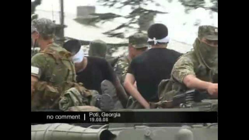 Захваченные в порту Поти грузинские военные и хаммеры принадлежащие США. Сюжет Euronews