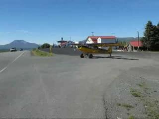 plane taking off in traffic in alaska