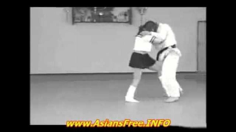 18 year old Japanese School Girl Practicing Judo throws