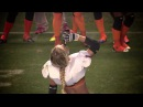 Alli Alberts surprises the crowd and announcers chugging a beer at mid-field, after being awarded Game MVP honors