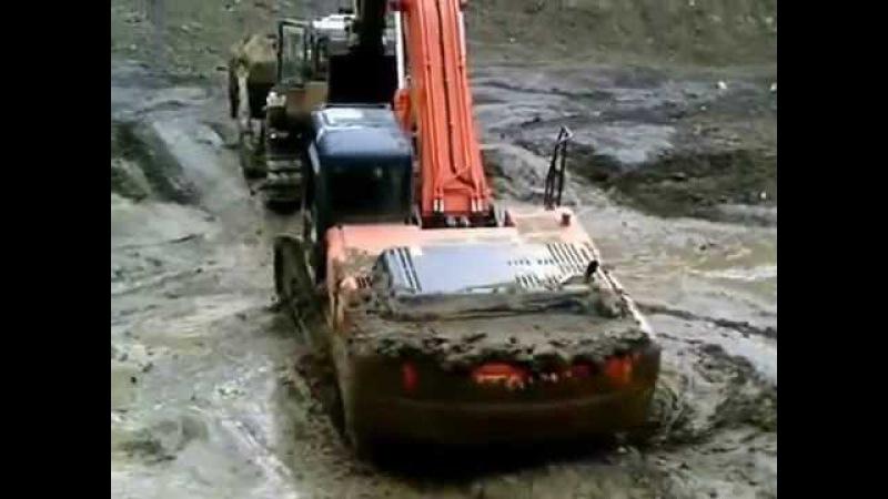 Экскаватор Hitachi в полной жопе и вылез из него