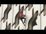«Человек-паук» Ален Робер взобрался на 36-этажное здание в дождь (новости)