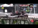 Two Muslim Arab Syrian guys help an old man walking the street in China online video cutter com