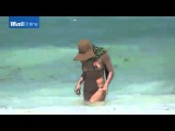 Irina Shayk swims in tiny string bikini...