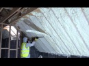 Spray foam of attic using fusion sprayfoam insulation being cut flush
