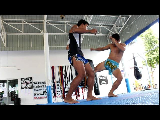 Muay Thai Technique 02 Low Kick / Leg Kick after slipping the jab, Kru Lucky @ Phuket Top Team
