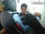 Latino boy shows feet