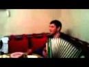 Даргинец играет на гармошке и поет
