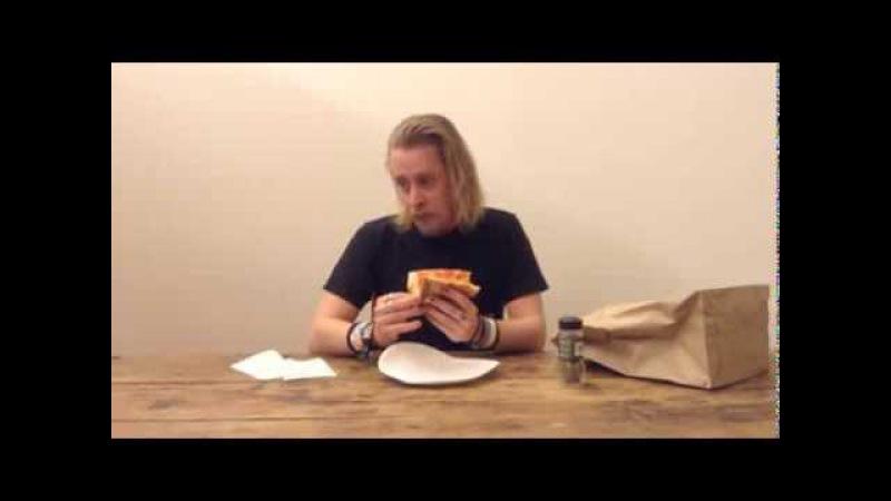 Macaulay Culkin Eating a Slice of Pizza