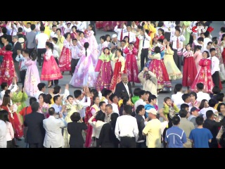 DPRK Holds Party for Tourists on Labor Day