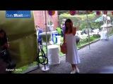 Miranda Kerr stuns in a floaty white Summer dress in NYC