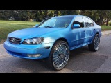 "2004 Infiniti i35...on 28"" DUB SWYRLS FLOATERS... WRAPPED METALLIC BLUE...WITH 16 TVs in it"