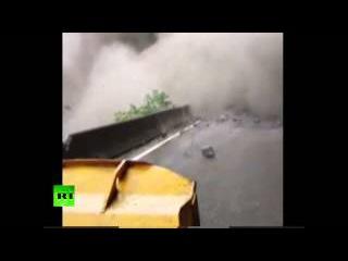 RAW: Moment massive landslide blocks Chinese highway